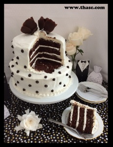 Two tiered Black And White Wedding Cake ready to serve.